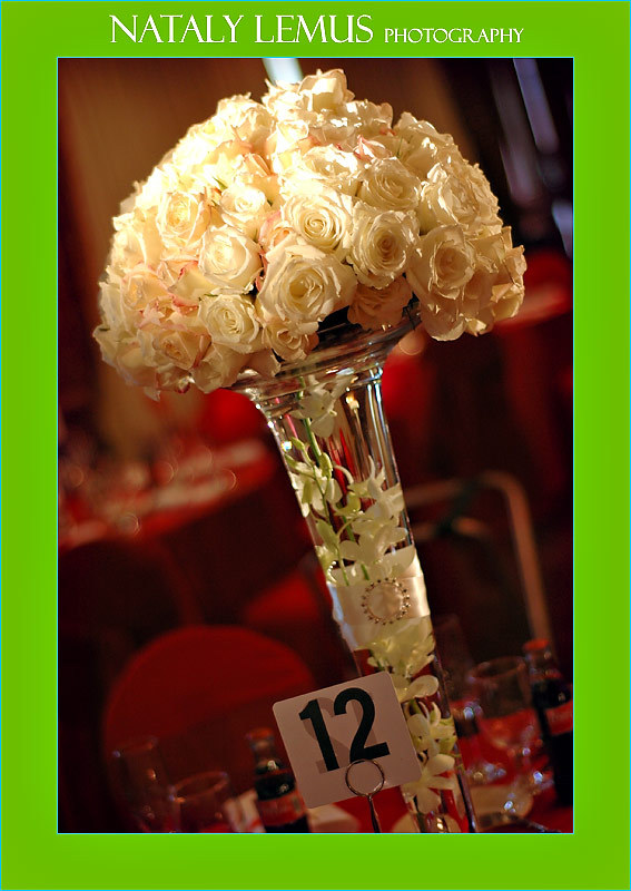 I love the use of the fabric and buckle on the tall centerpiece